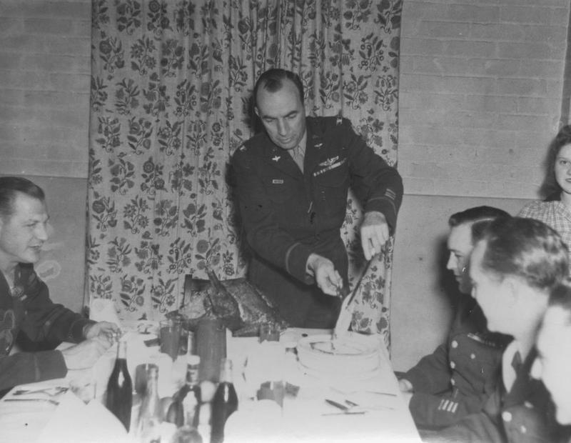 Group Commander Colonel Eugene H. Snavely carves the roast at the base of the 44th Bomb Group at Shipdham, Norfolk, 1944.