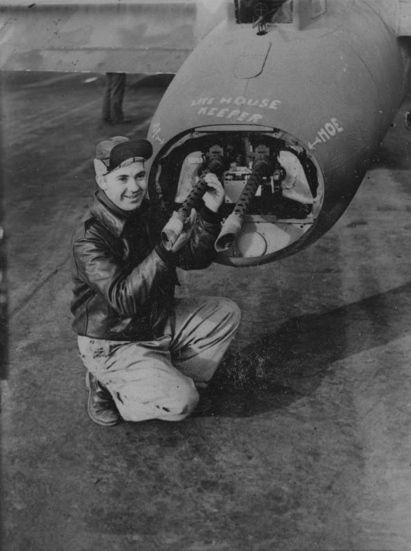 Staff Sergeant Walter Dager, a tail gunner of the 91st Bomb Group with his B-17 Flying Fortress at Bassingbourn airbase. Image stamped on reverse: '246383' [Censor no]. Passed for Publication 1 Feb 1943 [stamp]. Printed Caption on reverse: 'Some of the airmen from America who are taking part in the daily raids on enemy occupied territory and Germany, in their giant high altitude aircraft the