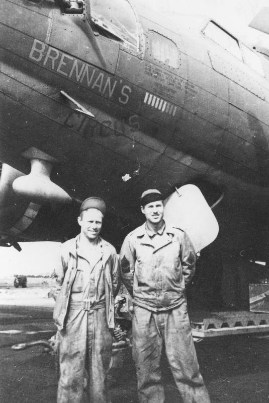 Two ground personnel of the 94th Bomb Group with a B-17 Flying Fortress (serial number 42-30383) nicknamed