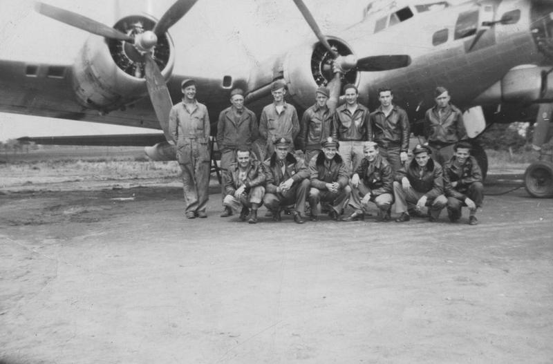 A bomber crew of the 94th Bomb Group with their B-17 Flying Fortress. Image stamped on reverse: '55.'[stamp] Handwritten caption on reverse: 'Fortress McHenry Victor Bonomo.'