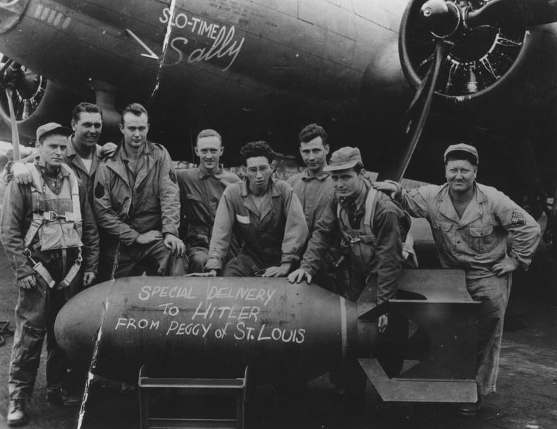 A bomber crew of the 94th Bomb Group stand with their B-17 Flying Fortress (serial number 42-30200) nicknamed