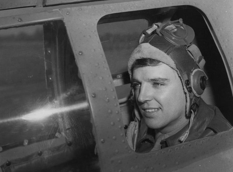 Staff Sergeant Donald W. Crossley, a tail gunner of the 95th Bomb Group in position inside a B-17 Flying Fortress. Image stamped on reverse: 'Associated Press.' [stamp] Handwritten caption on reverse: '21/9/43.' A printed caption was previously attached to the reverse of print, this has been lost, however considering the publication date, press agency and subject matter this was likely to have read: 'AWARDS TO THE HIGH-SCORING GUNNER. The Distinguished Flying Cross and an oak leaf cluster- the equivalent of two D.F.C's- have been award simultaneously to S/Sgt Donald W. Crossley, 25, of Wellsburg, W.VA., U.S. 8th Air Force tail gunner. Crossley, the highest scoring aerial gunner in the ETO, has shot down 12 German planes in 23 heavy bomber missions. The possessor of the Air Medal and the Oak Leaf Clusters, Crossley added a second cluster to his new DFC within a few days when his twelfth