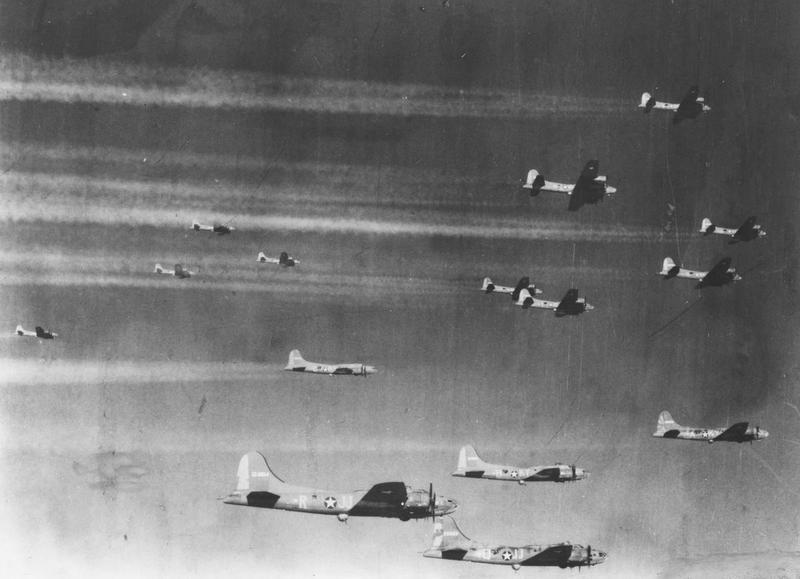 A flight of B-17 Flying Fortresses of the 305th Bomb Group, in formation returning from Lille. Printed caption on reverse: 'Vapor trails made by Boeing B-17's returning from Lille, France. US Air Force Photo.' Handwritten caption on reverse: 'KY-A, 25085?. KY-B, 124591