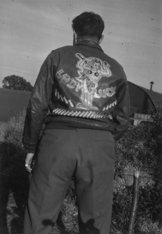 John A Miller, a waist gunner of the 100th Bomb Group wears an A-2 Flying Jacket decorated with the nose art of the B-17 Flying Fortress he flew in, a B-17 (serial number 42-102416) nicknamed