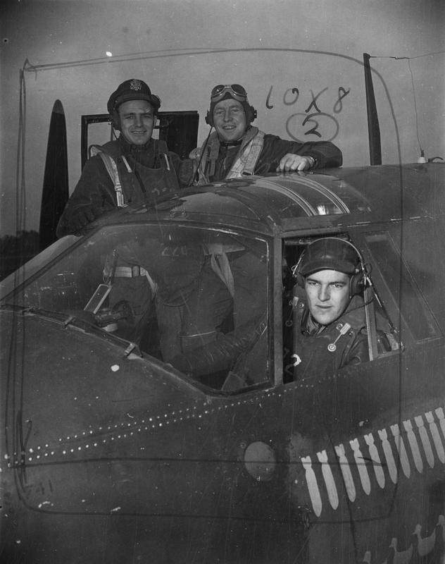 A crew of a B-26 Marauder of the 322nd Bomb Group in the cockpit of the aircraft. Image stamped on reverse: 'Passed for publication [illegible] Nov 1943.' [stamp] Handwritten caption on reverse: 'Crew of PN:N 131441. MIA 13/8/44.'