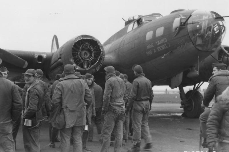 A bomber crew of the 379th Bomb Group with their battle damaged B-17 Flying Fortress (serial number 42-30720) nicknamed