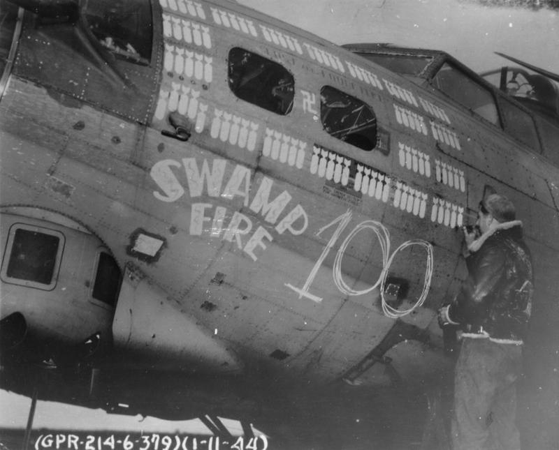 An airman of the 379th Bomb Group paints the 100th mission marking onto a B-17 Flying Fortress (serial number 42-32024) nicknamed