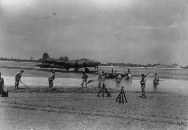 Engineers work to complete the runway, in time for the first B-17 Flying Fortress (serial number 42-3123) nicknamed