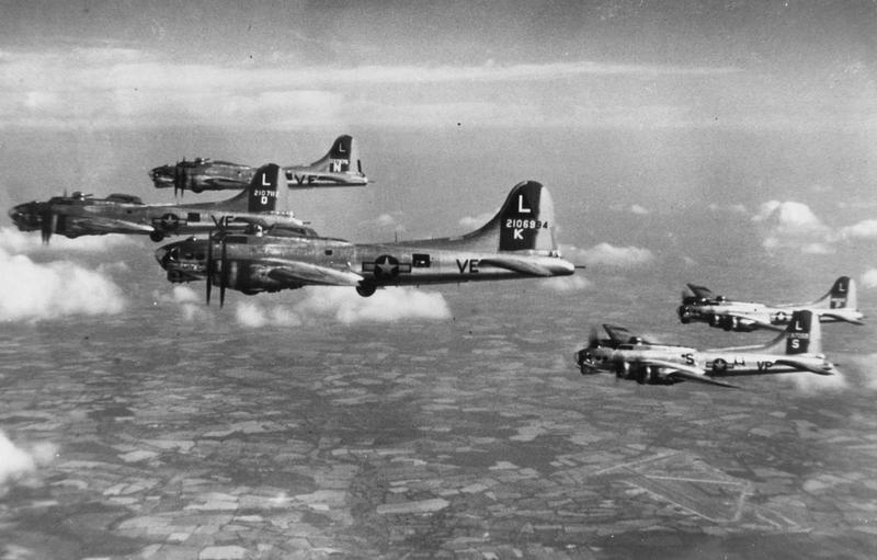 B-17 Flying Fortresses of the 381st Bomb Group fly in formation during a practice mission. The aircraft, left to right are: (VE-O, serial number 41-107112) nicknamed
