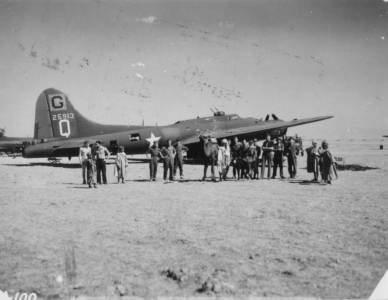 Airmen of the 385th Bomb Group meet civilians in front of B-17 Flying Fortress (serial number 42-5913) nicknamed