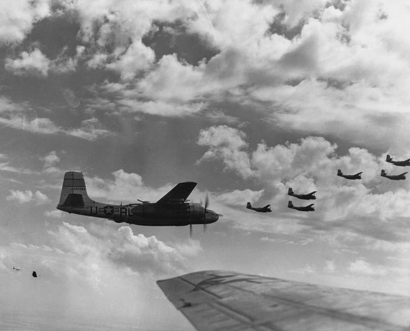A-26 Invaders of the 386th Bomb Group fly in formation during a mission. A-26 (RU-S, serial number 43-22366) is visible on the left. Printed caption on reverse: 'b-70171 AC- Formations of Douglas A-26s , attached to the 386th Bomb Group, enroute to bomb enemy installations somewhere in Germany on 20 April 1945. US Air Force Photo Detachment-5 Hq AAVS (mac).' Handwritten caption on revese: '554th Bomb Squadron, 386th Bomb Group.'