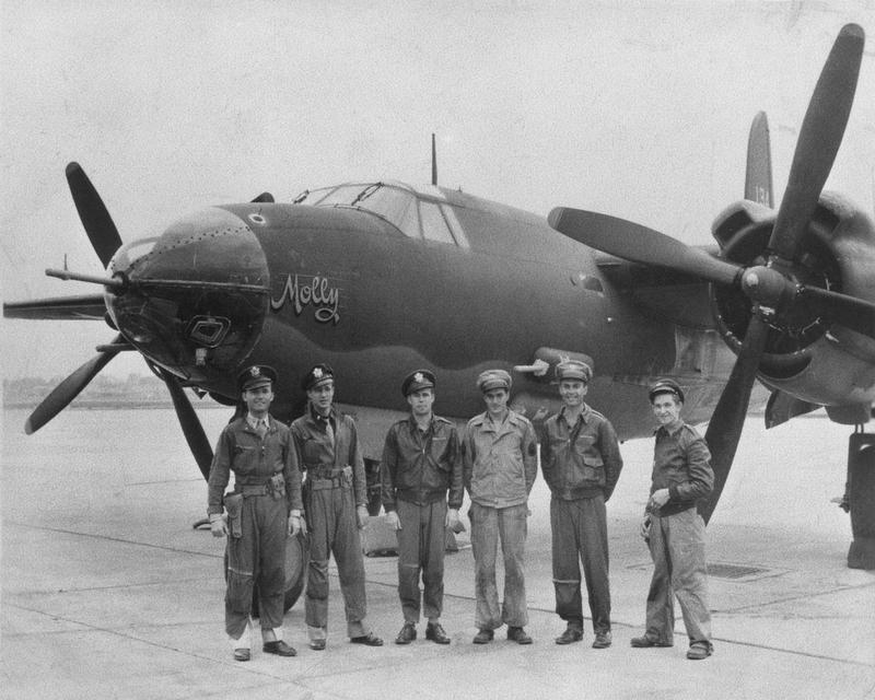 A bomber crew of the 553rd Bomb Squadron, 386th Bomb Group with their B-26 Marauder nicknamed