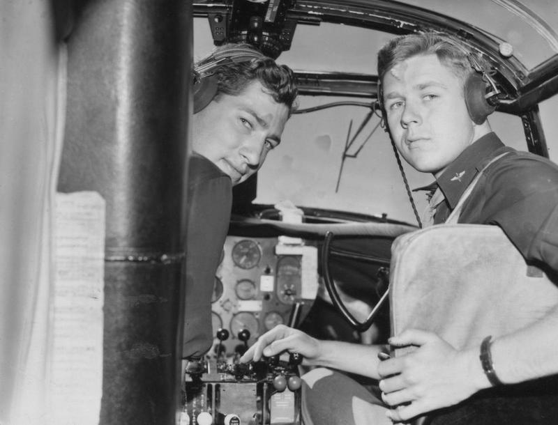 Lieutenant James T. Wilson and Lieutenant Robert J. Owen of the 386th Bomb Group in the cockpit of their B-26 Marauder. Image stamped on reverse: 'Not to be published.' [stamp], 'Ministry of Information 19 Aug 1943.' [stamp] nand '279545.' [Censor no.] Printed caption on reverse: 'AT THE US MARAUDERS BASE. The B-26 Marauders, American super medium bombers are operating now from bases in Britain. This series of pictures shows various scenes at the airfield where the ground crew and the fliers work together to deliver heavy blows against German Airports and industrial targets. Already the German Fighters which have attempted to intercept the Marauders, have felt the deadly sting of their concentrated fire power and many crews are credited with a couple of Jerries. Keystone Photo Shows: Inside a Marauder: Seated in their plane before take off L to R: Lt James T Wilson (South Strafford, Vermont), Lt Robt J Owen (Nashville, Tenn) US Pool/F Keystone.'