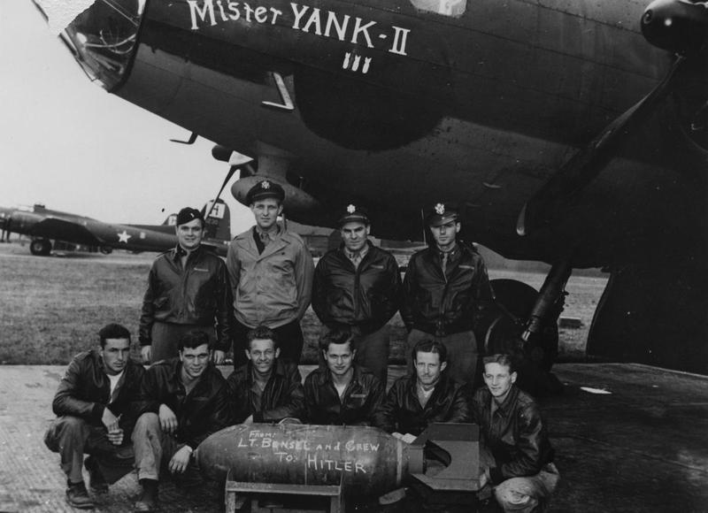 Paul Bensel Crew 388th BG - 562nd BS  Standing Left to Right:  Robert B. Leventhal (N), Paul P. Bensel (P), Phillip H. Pick (B), Glenn E. Kofoed (CP)  Kneeling Left to Right:  Glinford E. Walls (LWG), Victor J. Stackniewicz (BTG), Leander A. Haschke (FE), Bonnie Skloss (WG), Kenneth R. Willis (R/O), James H. Cruchon (TG)   Lieutenant Paul Bensel and his crew of the 388th Bomb Group stand with a bomb, personally addressed to Hitler, and their B-17 Flying Fortress (serial number 42-5954) nicknamed