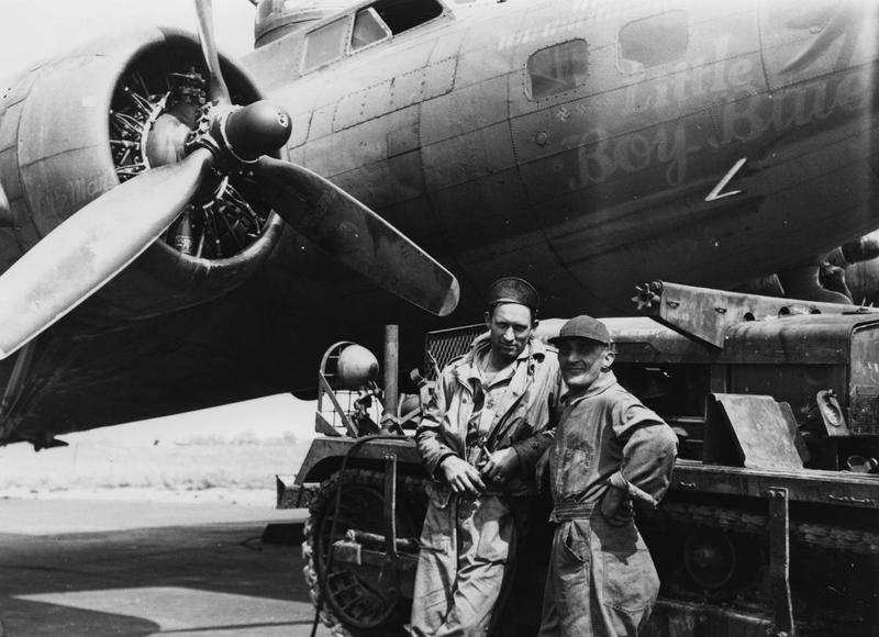 Ground personnel of the 388th Bomb Group with their Cletrac and a B-17 Flying Fortress (serial number 42-30851) nicknamed