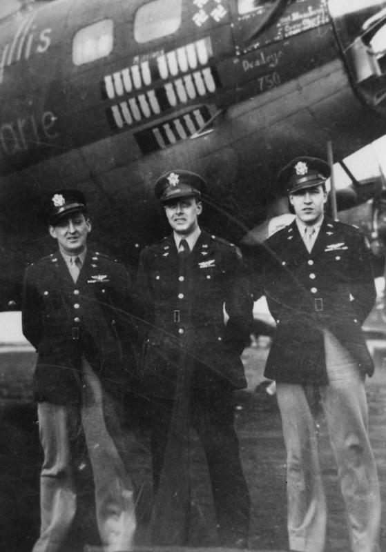 First Lieutenant Fitzsimmons, First Lieutenant Boettcher and Captain Row of the 390th Bomb Group with their B-17 Flying Fortress (serial number 42-30713) nicknamed