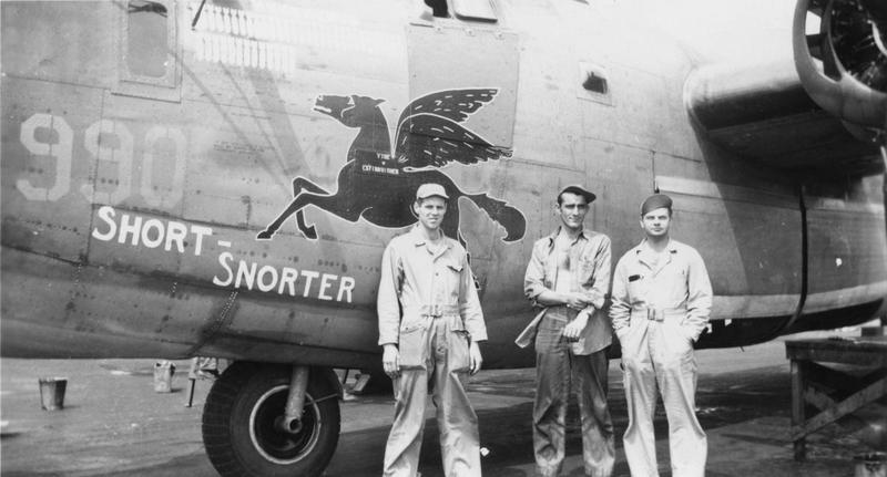 Three airmen of the 579th Bomb Squadron, 392nd Bomb Group, with B-24 Liberator (serial number 42-99990) nicknamed
