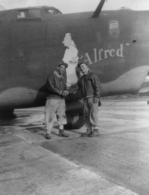 Two airmen of the 392nd Bomb Group with a B-24 Liberator (serial number 42-7485) nicknamed