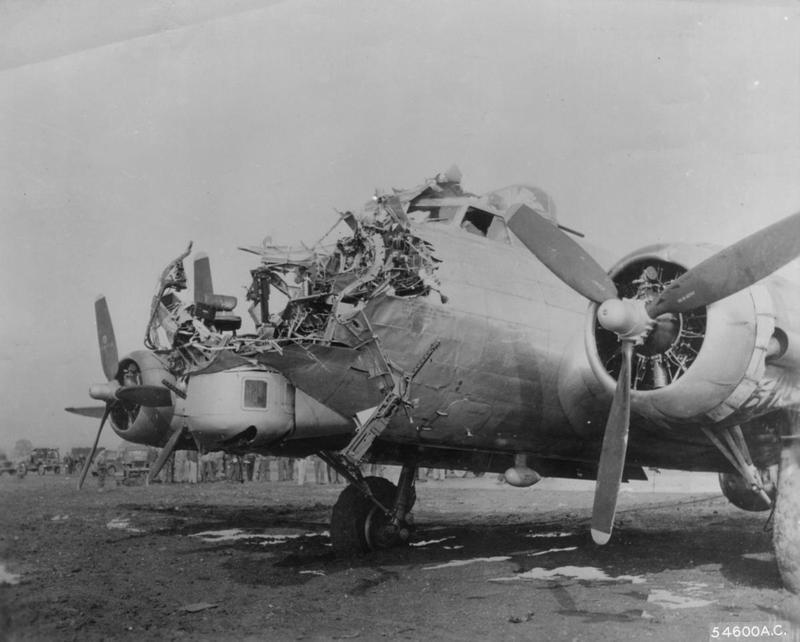 The flak damaged nose of a B-17 Flying Fortress of the 398th Bomb Group. Printed caption on reverse: '54600 AC- England- 1st lt Lawrence M De Lancey, Corvallis, Oregon, landed this B-17 safely after its nose was literally shot away by flak over Cologne, Germany. Please Credit: Official US Air Force Photo.' Printed caption on image: 'This B-17 landed safely after losing its nose to flak. US AAF Photo.' Handwritten caption on reverse: '43-38172 of 398th BG.'