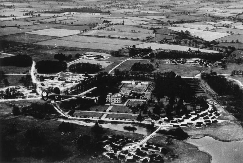 Five B-24 Liberators of the 445th Bomb Group fly in formation over Haveringland Hall, Norfolk. The Hall had been requisitioned by the Air Ministry. It would be demolished in 1946-1947.