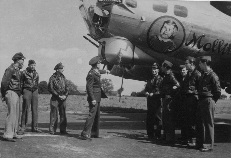 Colonel Thetus C Odom, Group commander of the 452nd Bomb Group christens a B-17 Flying Fortress (serial number 43-37817) nicknamed