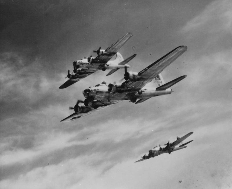 A B-17 Flying Fortress (serial number 42-102650) of the 452nd Bomb Group flies in formation with two comrades during a mission. Image via Harry Miller.