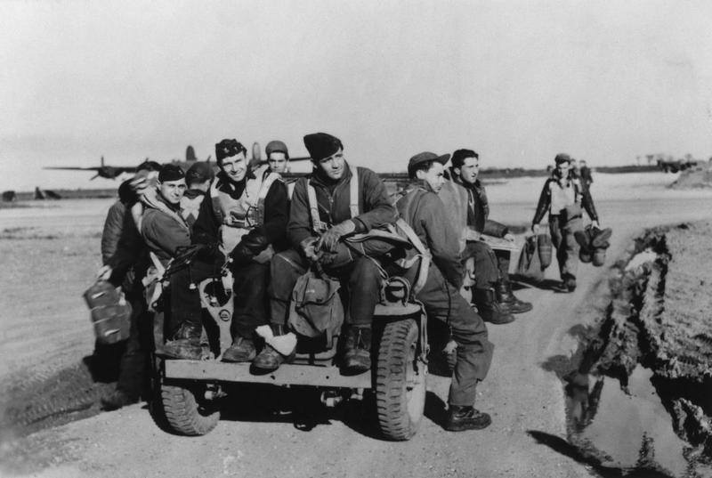 A bomber crew of the 453rd Bomb Group enjoying a ride on Jimmy Stewart's jeep at Old Buckenham, after completing their 32nd and final mission, 23 June 1944.   Letter enclosed with print: '[Left to Right] James E Terwilliger- Waist Gunner, Luther M Clark- Co-pilot, Carl Powell- Navigator, Lattie P Head- Nose Gunner, Nicholas Radosevich- Pilot, Edmund M Survilla- Tail Gunner, Lt ? Lee- Bombardier (Robert Burgess was the Bombardier on the original crew), Joseph D Craft- Radio operator, Robert Victor- Waist Gunner, Robert O Hanson- Engineer- Top Turret. Original Cadre- Model (Crew #41) 734th Squadron, 453rd Bomb Group.'