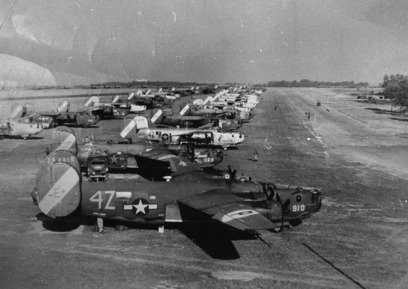"B-24 Liberators of the 467th Bomb Group lined up at RAF Welford. B-24 (4z-E+, serial number 42-94910) is visible in the foreground. It was taken during the first couple of days (most likely 15 or 16 Sept 1944) of the 'Trucking Missions"" that started 12 Sept 1944.  The 467th had a key role in ferrying fuel to bases on the continent to support Patton's 3rd Army.  Prior to Rackheath being ready to support the transfer of fuel, the 467th (along with other bomb groups of the 2nd AD) used the RAF bases at Welford, Horsham and Beaulieu.