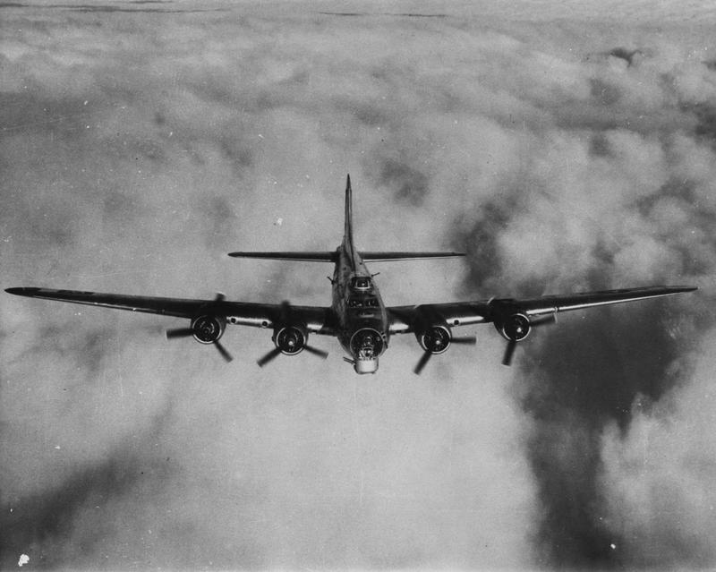 A B-17 Flying Fortress, fitted with a chin turret, of the 486th Bomb Group. Image via Roland A Andrews. Handwritten caption on reverse: 'B-17 G 486th B Group, Station 173 Sudbury.'