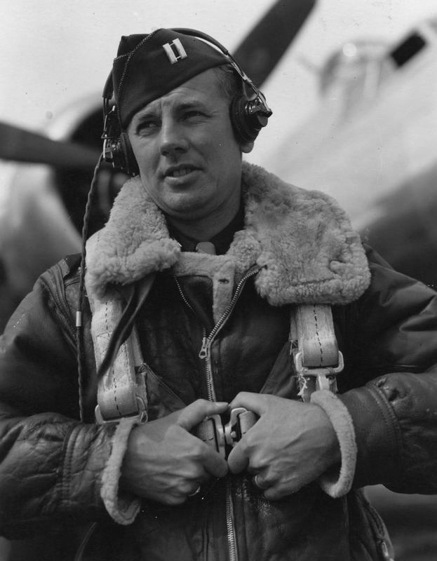 Captain Edmund F. Auer of the 487th Bomb Group in front of a B-17 Flying Fortress. Handwritten caption on reverse: 'Misch' This is Captain Edmund F. 'Misch' Auer, Army serial number O-795170, who was a lead navigator in the 838th Bomb Squadron of the 487th Bomb Group at Lavenham, Suffolk, England. His buddies in the service called him 'Misch', after the actor Mischa Auer. His good friend Doctor (Captain) Isadore Lerner, the 838th Bomb Squadron flight surgeon, explained: