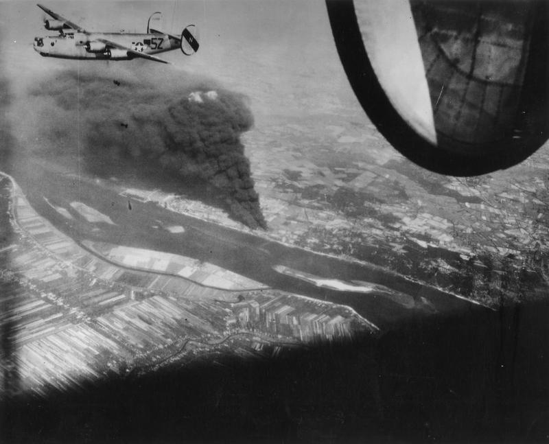 A B-24 Liberator of the 492nd Bomb Group bombs a target near Hamburg.   Handwritten caption on reverse: 'USAF- 492nd BG showing successful result on oil target near Hamburg, 6 Aug 1944.'