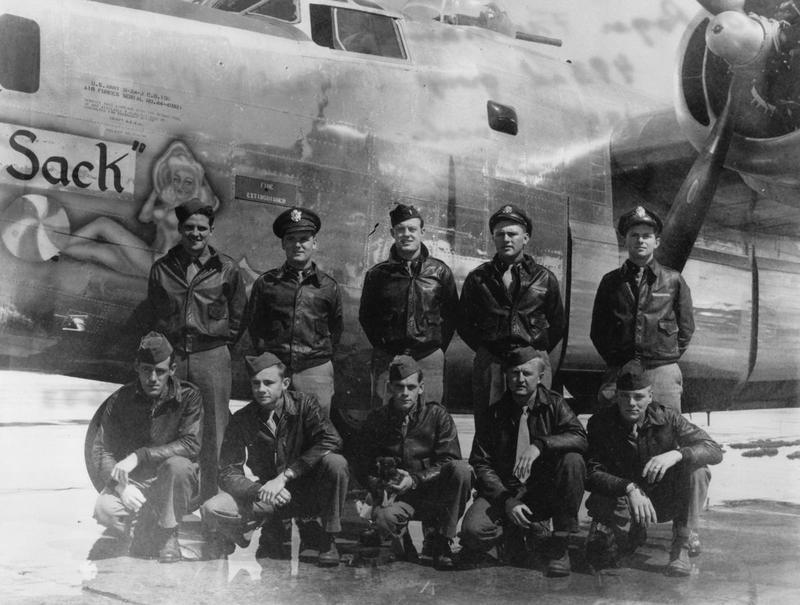 A bomber crew of the 493rd Bomb Group with their B-24 Liberator (serial number 44-40321) nicknamed