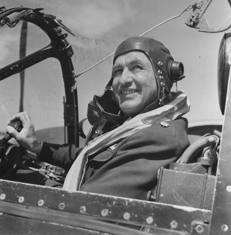 Colonel James Goodwin Hall of the 7th Photographic Reconnaissance Group in the cockpit of an F-5 Lightning. Image stamped on reverse: 'Esten Illustrated.' [stamp], 'Passed for Publication 8 Jul 1943.' [stamp] and '273522.' [Censor no.]. A printed caption was previously attached to the reverse, however this has been removed. Handwritten caption on reverse: '28/3/43.'