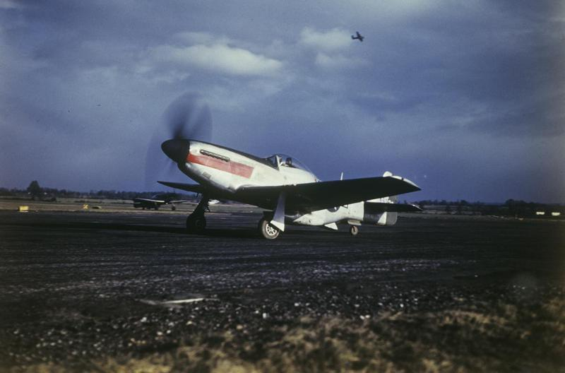A P-51, Mustang of the 27th Photographic Squadron, 7th Photographic Reconnaissance Group taxying at Mount Farm. Image by Robert Astrella, 7th Photographic Reconnaissace Group. Handwritten on slide: