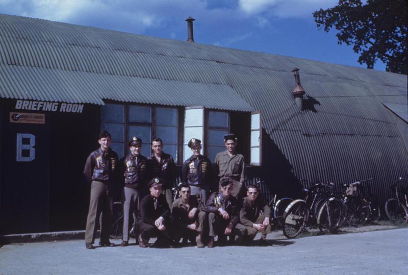 A bomber crew of the 95th Bomb Group outside a Nissen hut briefing room at Horham, August 1944. Image via Albert Keeler, 95th Bomb Group. Written on slide casing: '