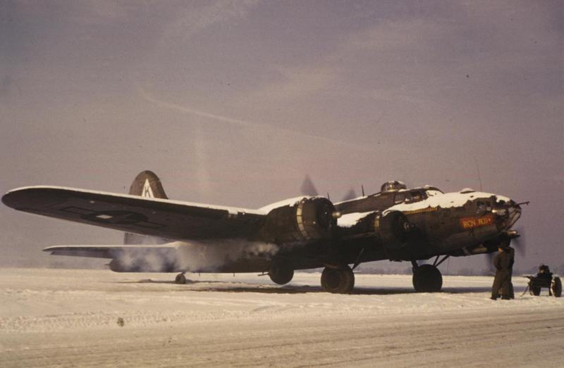 Ground personnel watch a B-17 Flying Fortress (FR-M, serial number 42-30298) nicknamed