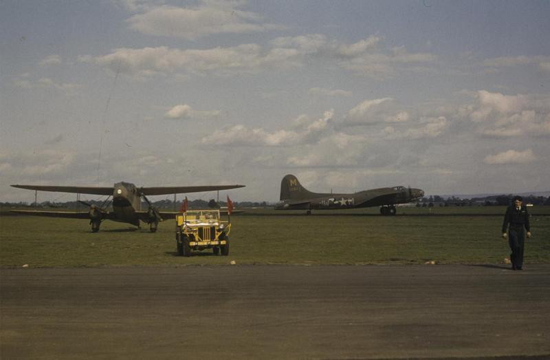 A B-17 Flying Fortress (JW-M, serial number 41-2629) used for training purposes, formerly of the 92nd Bomb Group and a Dragon Rapide, at Mount Farm. Image by Robert Astrella, 7th Photographic Reconnaissance Group. Written on slide casing: 'Mount Farm.'