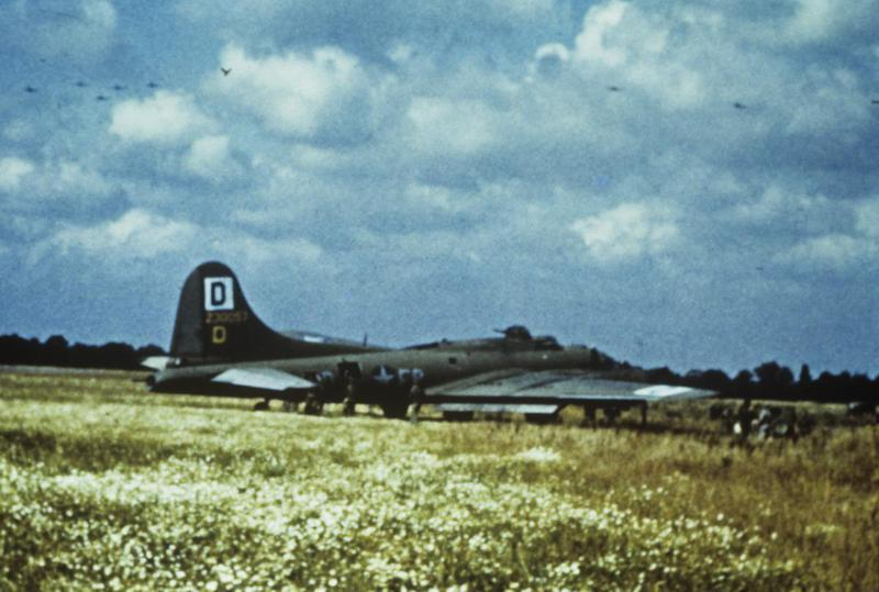 A B-17 Flying Fortress of the 100th Bomb Group ran off the end of the runway due to battle damage and no breaks. Flown by Capt. Sam R. Turner. 42-30057 EP-D.