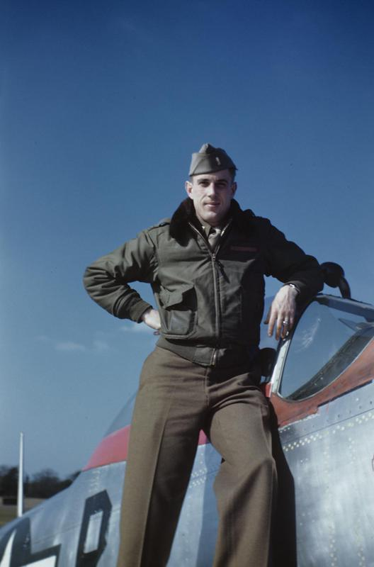 Lieutenant Herbert R Rutland Jr of the 356th Fighter Group with his P-51 Mustang (PI-R, serial number 44-72139). Written on slide casing: 'England, 1945 Herb himself (Herb Rutland).'