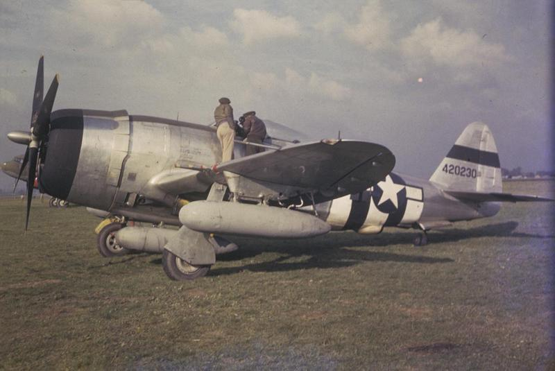 A P-47 Thunderbolt (serial number 44-20230) at Mount Farm. Image by Robert Astrella, 7th Photographic Reconnaissance Group Written on slide casing: 'P-47, Mount Farm.'