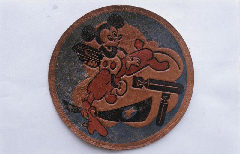 The insignia of the 349th Bomb Squadron, 100th Bomb Group. Featuring Mickey Mouse.