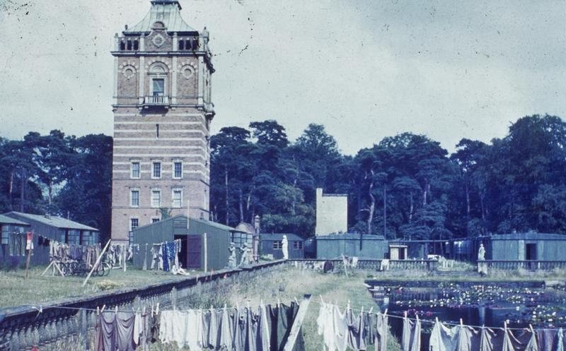 The water tower at Elveden Hall with washing hanging out to dry in the foreground. 