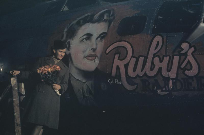 A member of the Women's Army Corps with a B-17 Flying Fortress (serial number 44-6483) nicknamed