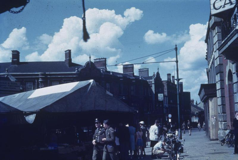 Kettering market, photographed by an airman of the 401st Bomb Group. Written on slide casing: 'Kettering Market 1944.'