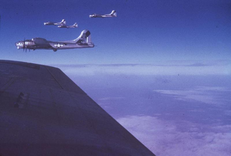 B-17 Flying Fortresses of the 457th Bomb Group fly in formation during a mission. B-17 (serial number 43-38301) nicknamed
