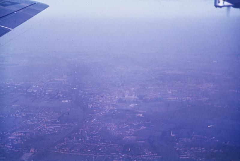 Peterborough Cathedral, heading south . Stanground in the foreground. Photographed from a B-17 Flying Fortress of the 457th Bomb Group. Image via LR Peterson. Written on slide casing: 'View of UK city.'