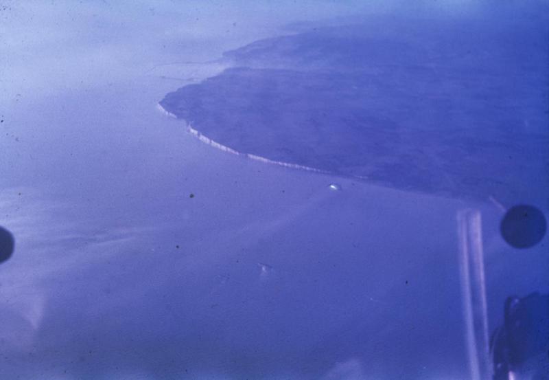 The White Cliffs of Dover, photographed from a B-17 Flying Fortress of the 457th Bomb Group. Image via LR Peterson. Written on slide casing: 'Dover area, from returning B-17.'