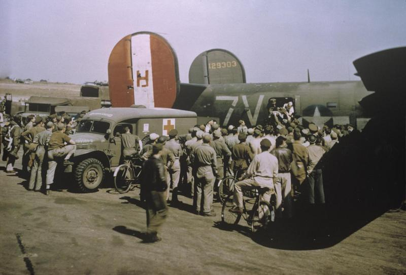 Personnel of the 458th Bomb Group gather around a B-24 Liberator (serial number 41-29303) nicknamed