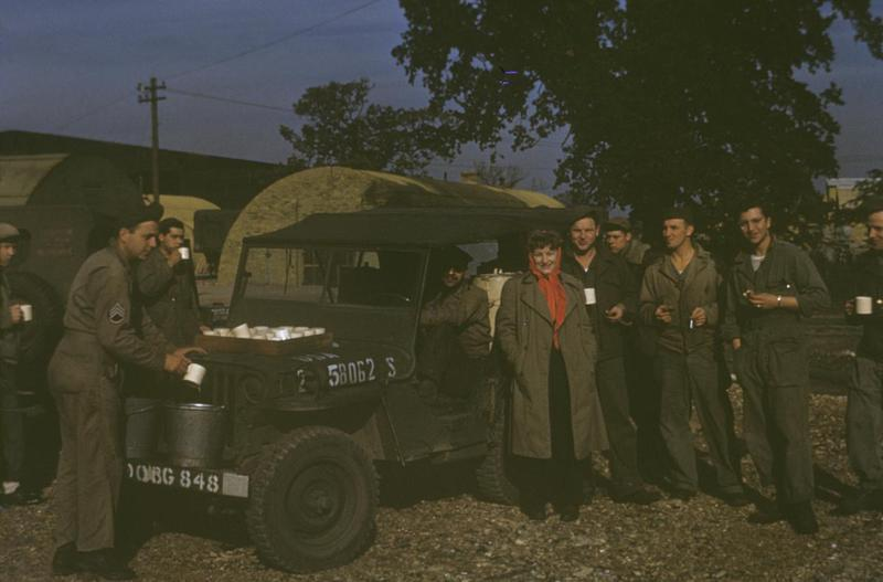 Personnel of the 490th Bomb Group enjoy coffee besides a Jeep. Image by Captain Arnold Delmonico, photographic officer 490th Bomb Group.