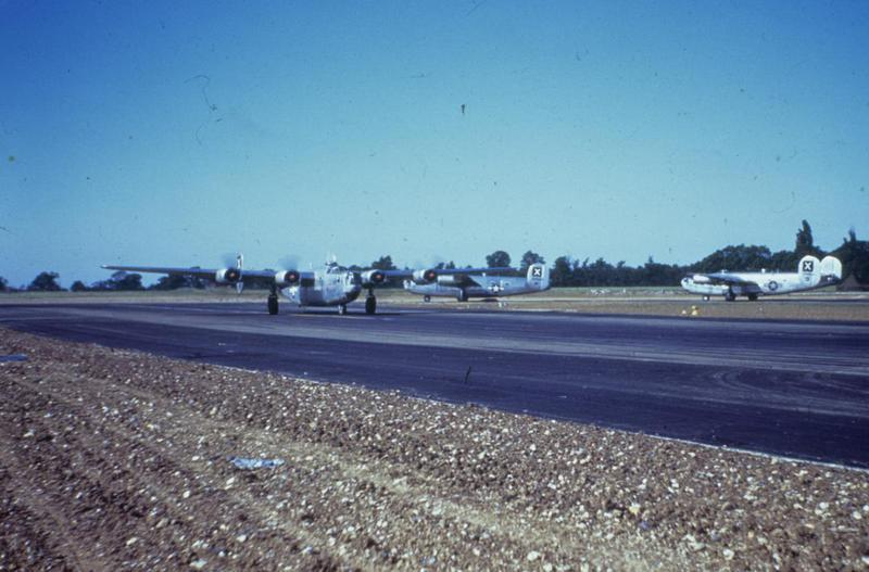 B-24 Liberators of the 493rd Bomb Group line up for take off. Image via Mark Brown, AFA. Written on slide casing: 'Debach.'